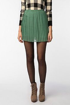 I love this green, I wish I could wear it well. I feel like it makes me look tanner, also. I have a cute pair of shorts in this color but no idea what to wear them with. But I'll definitely try a pair of tights with them, now.