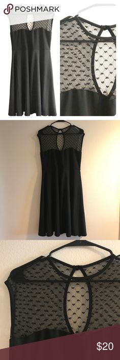 Black swing dress. Heart mesh detail! Size XL Perfect for Valentine's or any occasion! Black little dress with heart mesh detail. Swing dress flares out at hip. Size XL. Dresses
