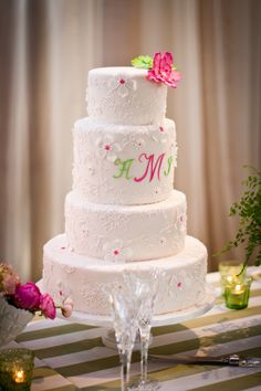 White Four Tier Wedding Cake with Pink and Green Floral Elements - The Celebration Society