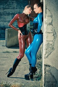 .Pretty models blue and brown latex bodysuits with black corsets shoes come last:-)