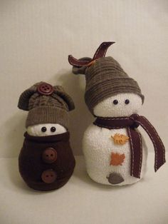 sock snowmen or snow babies as i like to call them, crafts, seasonal holiday decor, These two are made entirely of beans It makes them really heavy but they won t fall over I used fall colors for them They really can be left out all season Sock Snowman Craft, Sock Crafts, Snowman Crafts, Christmas Projects, Holiday Crafts, Christmas Ideas, Autumn Crafts, Fun Crafts, Halloween Decorations