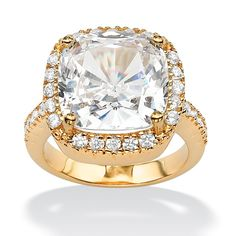 Cushion-cut with halo style setting.  Checkerboard cushion cut stones are hot hot hot right now.