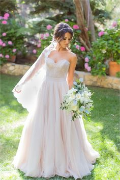 A Whimsical and Dreamy Calamigos Wedding. Bride in blush @watterswtoo Carina corset and Ahsan skirt.
