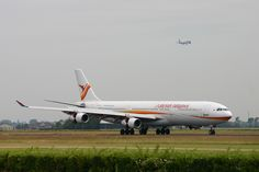 Surinam Airways A340 PZ-TCP seen after landing at Schiphol's Polder Runway while Qatar Cargo Boeing 777 Freighter A7-BFB is going to land at the Zwanenburg Runway (C/N 49)     Viettel IDC tại địa chỉ Tòa nhà CIT, Ngõ 15 Duy Tân - Cầu Giấy - Hà Nội: