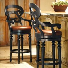 the great back on these bar stools and the curving arms give this stool a romantic European cottage influence