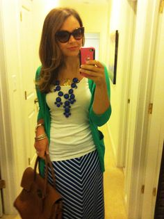 Love the green cardigan with the blue and white skirt.  I love the navy bubble statement necklace.