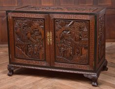 Out standing side cabinet made from solid camphor wood and profusely carved with oriental scenes and and figures the doors to the front open to reveal the same carved interior comprising of two short drawers and 2 full length drawers raised on carved paw feet on excellent condition. Edwardian periood. Antiques Atlas #chinesecabinet #camphorwood #antiquecabinet Chinese Cabinet, Antique Chinese Furniture, Antique Chest, Antique Cabinets, Cabinet Making, Ravioli, Oriental, Drawers, Carving