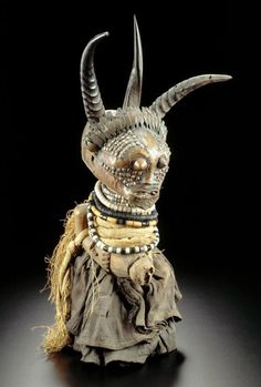 Africa | Power figure from the Songye people of Kasaï, DR Congo | Wood, raffia, horn, leather, metals, bead | ca. 1948