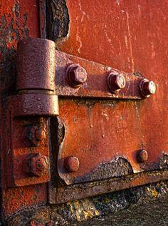 Rusting door hinge by Languard point Felixstowe. Photo by Paul Templeton