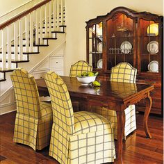 Remove walls. Many old houses feel a bit boxy and closed in. Simply removing some non-load bearing walls can really open things up. This stairway becomes a charming part of the dining room instead of a closed off space.