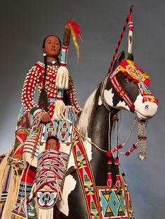 Rhonda Holy Bear (Cheyenne River Lakota), Maternal Journey (detail), 2010. Wood, hide, cloth, paint, glass beads, hair, shell, metal. Photo by Mark Damon, courtesy of the artist.