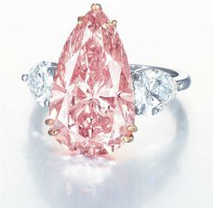 9.38 Carat Ring - Fancy Intense Pink Pear Cut Diamond Flanked by White Diamonds and Set In Platinum