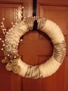 Super cute winter wreath just rap yarn around a foam circle and make some felt flowers!