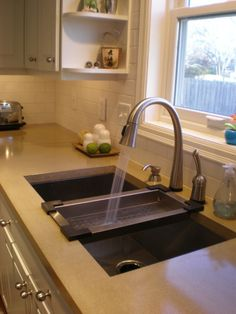 Deep sink, with a cleaning strainer piece like this, but also built in drain board that is slightly recessed down