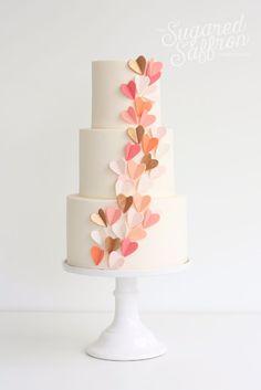 3 layer ivory fondant wedding cake with cascading folded hearts ~ we ❤ this! moncheribridals.com