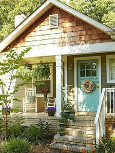 Go Whimsical in Your Color Approach. Teal front door and gray grey exterior on house home. (IDEA for front porch) Go Whimsical in Your Color Approach. Teal front door and gray grey exterior on house home. (IDEA for front porch)