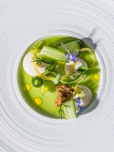 Spring cucumber with brioche pudding, Meyer lemons dill juice, and blooms by chef Curtis Duffy of Grace, Chicago. © Anthony Tahlier - See more at: http://theartofplating.com/editorial/photographer-anthony-tahlier/#sthash.59dt8dtw.dpuf