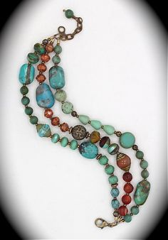 One-of-a-kind three strand bracelet: turquoise, coral, & vintage beads.