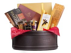 Godiva Discovery Hamper  Spoil your loved ones with this journey into Godiva's favourites. In this exquisite leather basket, let your palette experience the wide range of the chocolate lover. Discover the essence of Godiva through our signature Gold gift box filled with a wide range of Belgian chocolates.
