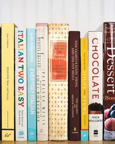 Cookbooks are fine on open shelves, so long as they're not exposed to humidity and grease from the fridge or stove.