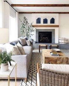 Neutral family room with Moroccan rug, beautiful modern traditional fireplace wi. Neutral family room with Moroccan rug, beautiful modern traditional fireplace with simple wood beamed mantle and concrete surround, concrete hearth. Modern Farmhouse Living Room Decor, Coastal Living Rooms, Living Room Modern, Rugs In Living Room, Home And Living, Living Room Furniture, Living Room Designs, Living Spaces, Farmhouse Style