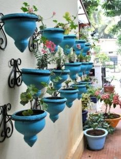 Beautiful outdoor wall art with planters. This link also has many other creative planter ideas. Outdoor Planters, Hanging Planters, Outdoor Gardens, Planter Pots, Wall Planters, Planter Ideas, Garden Planters, Balcony Planters, Gravel Garden