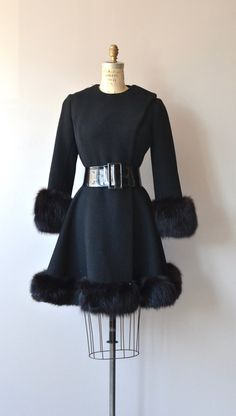 Stunning vintge 1960s black wool coat with black fox fur cuffs and wide black fox fur hem, fitted waist with wide black belt, asymmetrical snap