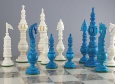 "This chess set intricately carved in camel bone is truly exquisite in a unique turquoise color! It is a replica of the design in the London Museum which was passed by King James II of England to Samuel Pepys during the 17th Century.The King is a full 7"" tall and the King's base size is 1 11/16""with billiard felt pads."
