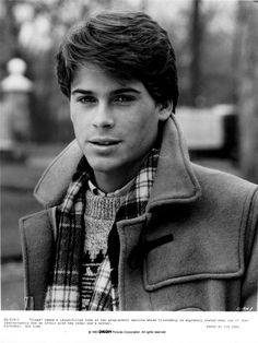 Such perfect layering. And such perfect hair. Clearly, Rob Lowe was a cutie back in the day!