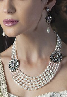 Necklace and earrings in victorian finish with cubic zircon and pearl mala by Benzer priced at $129. Buy online at www.benzerworld.com