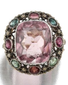 A vintage gem-set ring, Buccellati, 1930. Centring on a cushion-shaped kunzite within an openwork bezel set with circular-cut tourmalines.