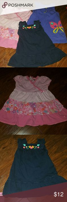 3 dress bundle All good condition, carter's purple with butterfly, carter's navy with embroidered flowers and children's place pink striped and floral tier dress. All 18 months, worn a few times. children's place and carters Dresses Casual