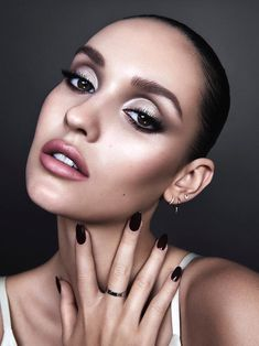 Glamorous night time makeup look with silver eyeshadow and shimmer
