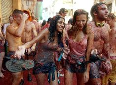 Girls covered in tomato pulp take part in the annual Tomatina battlein 2003