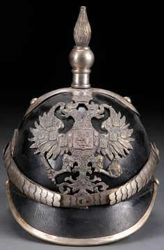 AN IMPERIAL RUSSIAN-STYLE OFFICERS SPIKED HELMET, probably 2nd half of 20th century, the leather body trimmed with metal edging, the front set with the Imperial double-headed eagle plate and finial spike forming the ordinance insignia (flaming shell).