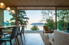 Heliotrope Architects designed Lone Madrone, a contemporary retreat set on a rocky, windswept shoreline of Washington state's Orcas Island.