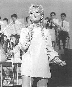 Petula Clark (English singer actress composer) She started entertaining during WWII on the radio and made her first hits in French and English. She wasn't truly recognized internationally until the 1960's with Downtown, I Know A Place, My Love, Color The World, A Sign Of The Times, and  Don't Sleep In The Subway.