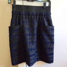 3.1 Phillip Lim Skirt Adorable cinched waist fit. Elastic waist, zip up back. Pockets on both sides! Length hits just above the knees. The skirt is too small for me to model, which is why I am selling this gorgeous piece. Blue and black tribal style embroidery. Never been worn. 3.1 Phillip Lim Skirts