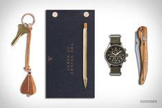 EDC: WRITE HOME Parabellum Arrow Keychain ($125). Ystudio Brassing Postcard ($17). Ystudio Classic Pen ($100). Timex Expedition Scout Chronograph ($89). Baladéo Laguiole Variation Knife ($21).