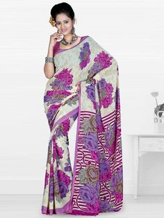 Go for light faux georgette this summer and feel comfortable. This multi colored saree gives you a charming look. The saree has floral print all over which gives you a feminine look. This saree is perfect for any casual occasion. The matching designer blouse adds to the beauty to it. (Slight variation in color is possible)