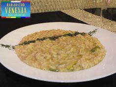 Carnaroli in risotto agli asparagi verdi, mantecato al Parmigiano.
