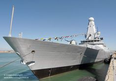 HMS Dauntless, the second of the Royal Navy's new formidable Type 45 destroyers, is pictured in Portsmouth, dressed for her commissioning into the Royal Navy on 3rd June 2010.
