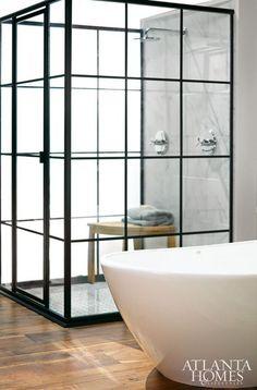 Splendor in the Bath. The steel framed shower enclosure is modeled after vintage factory windows. Interior Designer Dylan Gilliam of Home ReBuilders. Steel Frame Doors, Trendy Bathroom, Shower Enclosure, Bathroom Shower Tile, Bathroom Shower Doors, Shower Doors, Bathroom Decor, Beautiful Bathrooms, Bathroom Inspiration