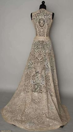 """BRUSSELS MIXED LACE WEDDING GOWN, 1940 - #  Era:  1920-1949    Handmade bobbin & Pt de Gaz needle lace c. 1860-1870, possibly a veil remade into wedding gown c. 1940, fitted sleeveless bodice, full open-front, skirt w/ train, B 34"""", W 24"""", (brown stains) very good; t/w 1 1940 cream underdress, poor. BROOKLYN MUSEUM"""