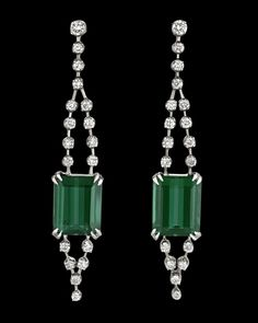 Tourmaline and Diamond Earrings by H. Stern~ Brilliant and bold, two rare emerald-cut green tourmalines totaling approximately 7.00 carats dazzle beyond measure in these elegant drop earrings by H. Stern. Displaying an attractive deep blue-green hue, these stones represent the tourmaline at its very best, with a rich coloration that sets them apart from other green gemstones such as the emerald and peridot. ~M.S. Rau Tourmaline Jewelry, Green Tourmaline, Rare Gemstones, Green Gemstones, Diamond Drop Earrings, Alexandrite, Emerald Cut, Deep Blue, Peridot