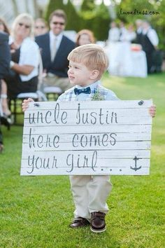 """Here Comes the Bride"" sign… AND it's carried by an adorable little cherub? Come on, too cute!!"