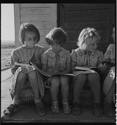 hollyhocksandtulips:    Girls of Lincoln Bench School study their reading lesson. Near Ontario, Malheur County, Oregon, 1939.  Photo by Dorothea Lange