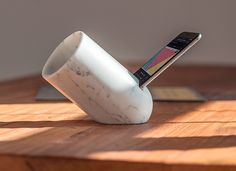 A passive iphone amplifier made from carrara marble, produced by altamura, puglia-based company Monitillo Marmi.