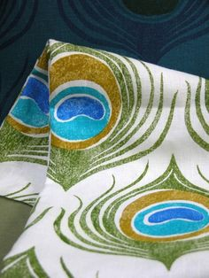 I love this linen fabric with a peacock print on it.  Thinking of a runner for my kitchen table...hmm