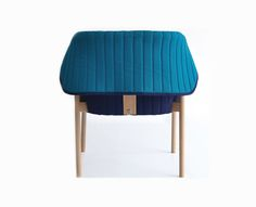 The Reves chair, designed for comfort and style by Spanish studio Muka Design Lab, is a unique chair with a hood. The quilted back flap of the Reves can stand up straight or can be folded down.